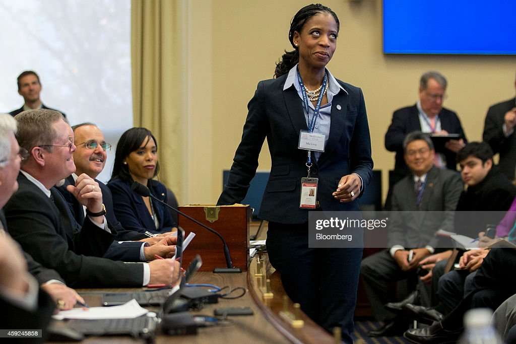 Representative-elect <a gi-track='captionPersonalityLinkClicked' href=/galleries/search?phrase=Mia+Love&family=editorial&specificpeople=8937528 ng-click='$event.stopPropagation()'>Mia Love</a>, A Republican from Utah, picks a number during a member-elect room lottery draw on Capitol Hill in Washington, D.C., U.S., on Wednesday, Nov. 19, 2014. Freshmen lawmakers draw numbers that dictate the order in which they can choose among the empty office spaces passed over by more senior lawmakers. Some offices are larger than others, some have nice views of Washington and some are closer to the floor where the members will vote. Photographer: Andrew Harrer/Bloomberg via Getty Images