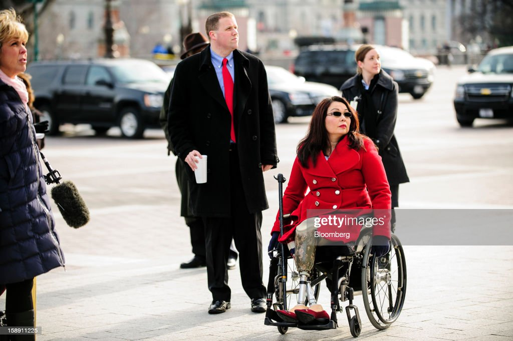 Representative-elect Tammy Duckworth, a Democrat from Illinois, arrives at the U.S. Capitol in Washington, D.C., U.S., on Thursday, Jan. 3, 2013. Duckworth lost both legs after her helicopter was shot down in Iraq in 2004. The 113th Congress convenes today in Washington where new members will try to meld their diverse backgrounds in a legislature containing a record seven openly gay lawmakers, an unprecedented 20 women in the Senate and the first all-female state delegation, from New Hampshire. Photographer: Pete Marovich/Bloomberg via Getty Images