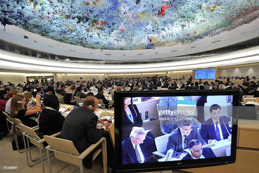 Representatives attend the United Nations Human Rights Council session under a painting on the ceiling by Spanish artist Miquel Barcelo on September...