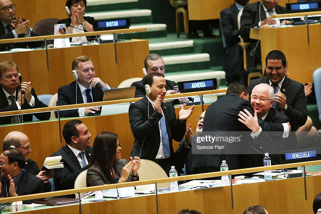 UN representatives for Venezuela including Foreign Minister Rafael Ramrez celebrate after being elected to a two year term as a nonpermanent member...