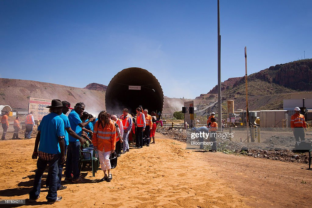 Representatives from the Mirriuwung and Gidja people, the traditional owners of the land, perform a Manthe ceremony with Rio Tinto Group employees during the opening of the company's underground expansion of the Argyle diamond mine in Kimberley, Australia, on Tuesday, April 30, 2013. Production at Argyle, which supplies more than 90 percent of the world's pink diamonds, will rise to 20 million carats annually as production moves underground, while costs will fall. Photographer: Ian Waldie/Bloomberg via Getty Images