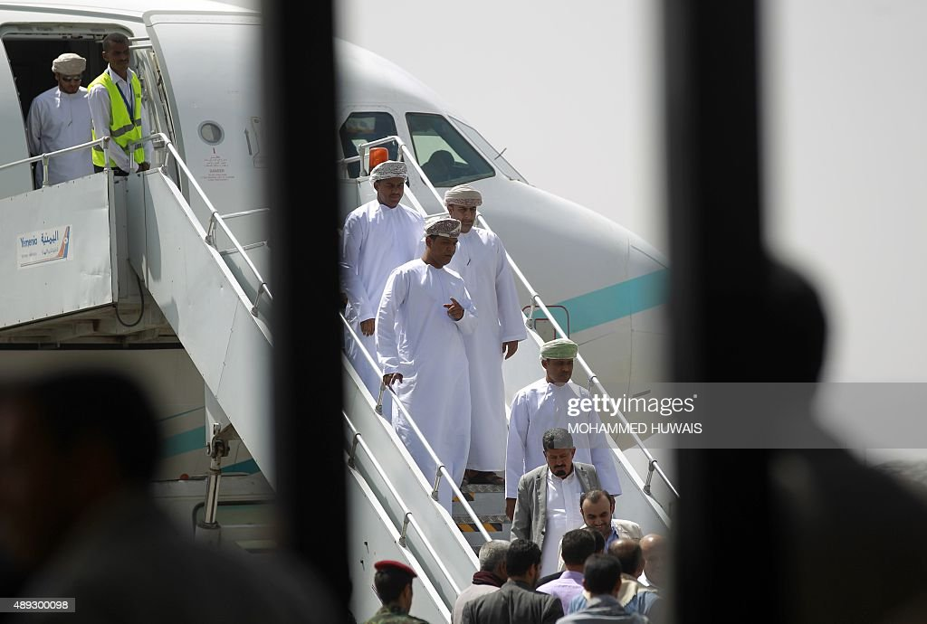 Representatives from the Omani government disembark a Royal Air Force of Oman plane at the Sanaa International airport in the Yemeni capital as three...