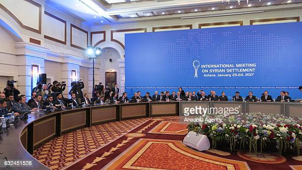 Representatives from the Syrian government and the opposition delegation take part in the first session of Syria peace talks at Astana's Rixos...
