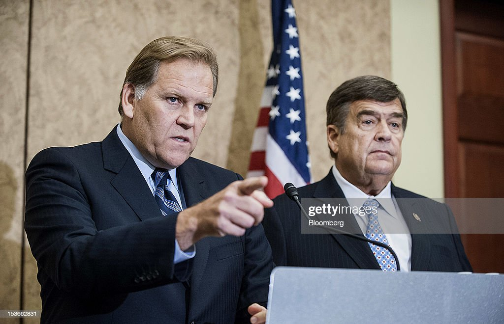 Representatives Mike Rogers, a Republican from Michigan and chairman of the House Intelligence Committee, left, and Dutch Ruppersberger, a Democrat from Maryland, address the media during a news conference in Washington, D.C., U.S., on Monday, Oct. 8, 2012. U.S. companies should avoid business with Huawei Technologies Co., China's largest phone-equipment maker, to guard against intellectual-property theft and spying, Rogers said. Photographer: Jay Mallin/Bloomberg via Getty Images