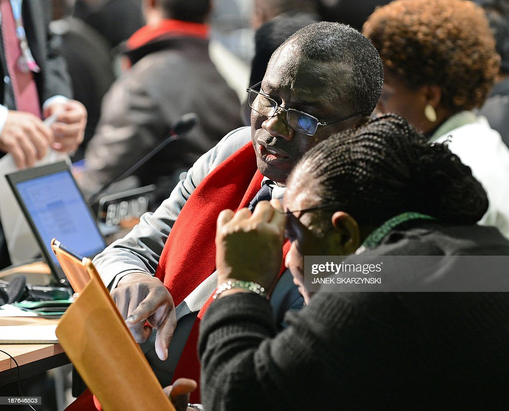 Representatives of Burkina Faso attend the plenary session of the United Nations Climate Change Conference COP 19 on November 11, 2013 in Warsaw. The 12-day United Nations Climate Change Conference comes amid a slew of warnings about potentially disastrous warming unless humankind changes its atmosphere-polluting, fossil-fuel-burning ways.