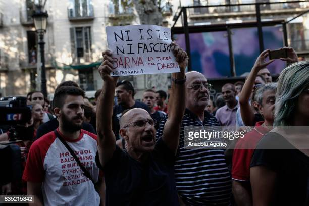 Representatives of Catalan organizations and people clash with a group of protesters who stage an anti Islamic protest at La Rambla street after...