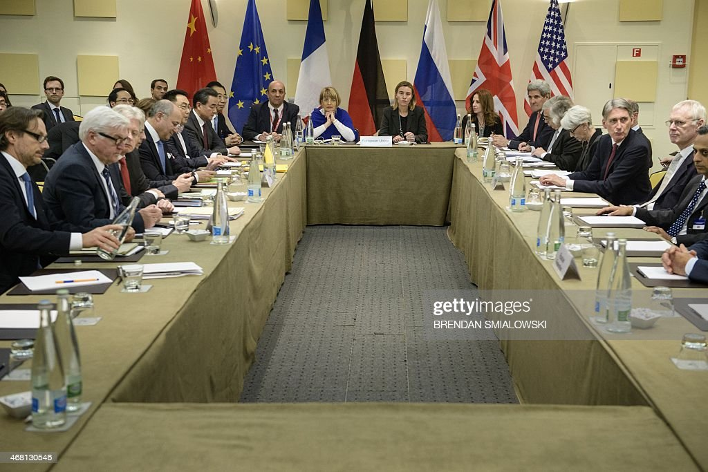 Representatives of European and world powers pose prior to meeting to pin down a nuclear deal with Iran on March 30 2015 at the Beau Rivage Palace...