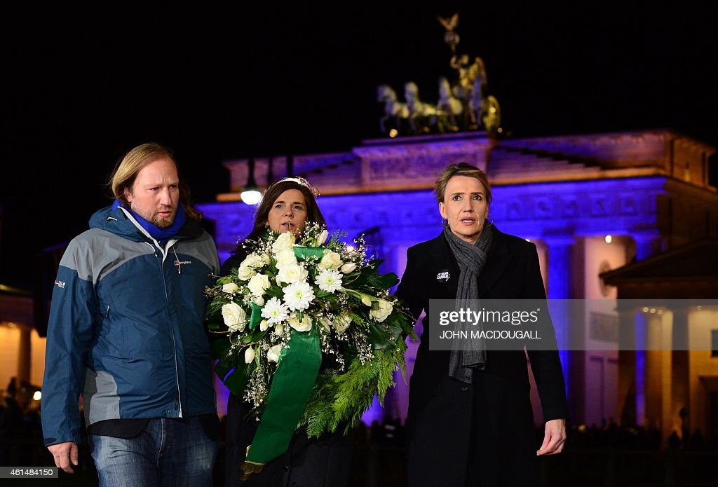 Representatives of Germany's Green party (L-R) <a gi-track='captionPersonalityLinkClicked' href=/galleries/search?phrase=Anton+Hofreiter&family=editorial&specificpeople=11451109 ng-click='$event.stopPropagation()'>Anton Hofreiter</a>, <a gi-track='captionPersonalityLinkClicked' href=/galleries/search?phrase=Katrin+Goering-Eckardt&family=editorial&specificpeople=5335700 ng-click='$event.stopPropagation()'>Katrin Goering-Eckardt</a> and <a gi-track='captionPersonalityLinkClicked' href=/galleries/search?phrase=Simone+Peter&family=editorial&specificpeople=9069989 ng-click='$event.stopPropagation()'>Simone Peter</a>, lay a wreath in front of the French embassy in Berlin, where the German Chancellor along with political and religious leaders were also expected later to attend a Muslim community rally to condemn the Paris jihadist attacks, promote tolerance and send a rebuke to a growing anti-Islamic movement, on January 13, 2015. Announcing the vigil, the Muslim Council and the Turkish Community of Berlin had condemned 'the despicable terror attacks in France in the strongest terms' and stressed that 'there is no justification in Islam for such acts.'