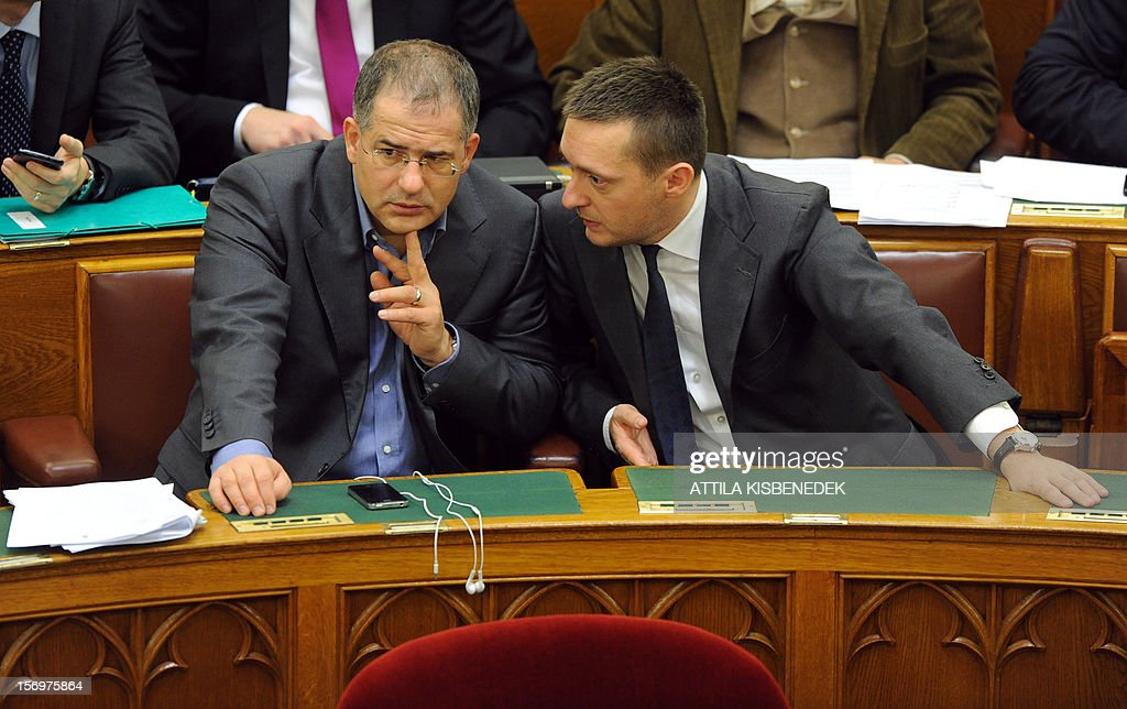 Representatives of governor FIDESZ party, fraction leader of the FIDESZ parliament group Antal Rogan (R) and Lajos Kosa talk in the main hall of the parliament building in Budapest on November 26, 2012 prior to the election of the new election law. Hungary's parliament was set to approve a shake-up of the electoral system that critics say is a cynical attempt by Prime Minister Viktor Orban to boost his chances of winning another term in 2014.