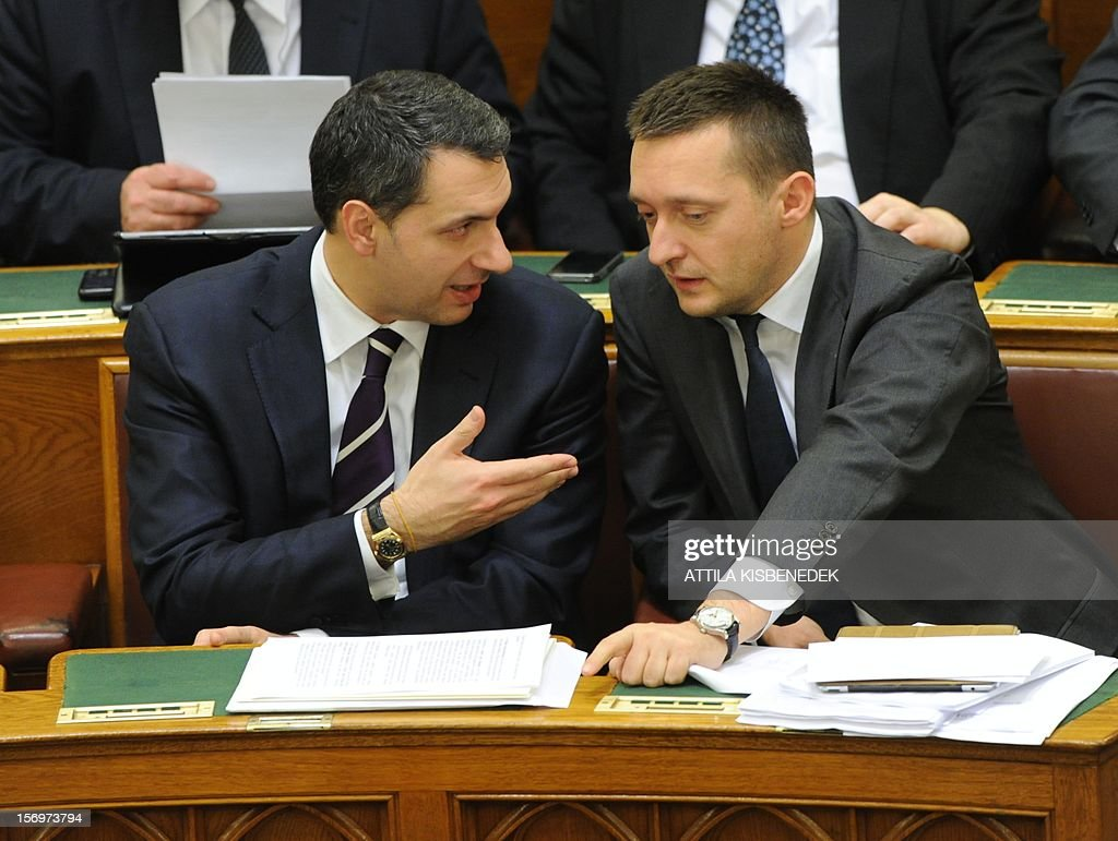 Representatives of governor FIDESZ party, leader of the prime minister office, state-secretary Janos Lazar (L) and fraction leader of FIDESZ parliament group Antal Rogan (R) talk in the main hall of the parliament building in Budapest on November 26, 2012 prior to the election of the new election law. Hungary's parliament was set to approve a shake-up of the electoral system that critics say is a cynical attempt by Prime Minister Viktor Orban to boost his chances of winning another term in 2014.