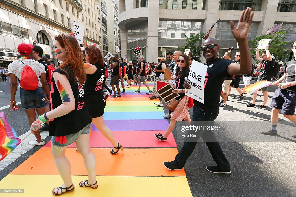 Representatives of Housing Works join the 2016 LGBT Pride March on June 26, 2016 in New York City.