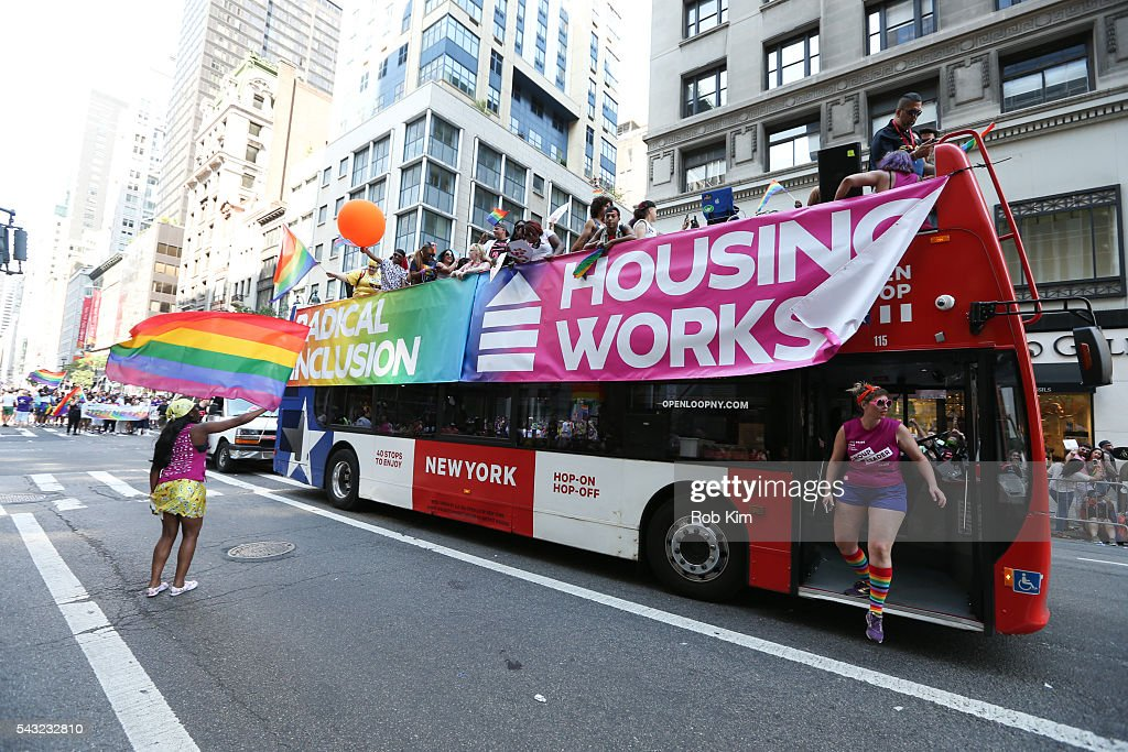 Representatives of Housing Works ride the Housing Works Bus during the 2016 LGBT Pride March on June 26, 2016 in New York City.