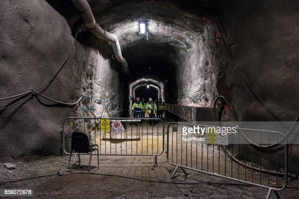 Representatives of Teollisuuden Voima Posiva and media in a demonstration tunnel approximately 420 meters underground at Posiva's spent nuclear fuel...