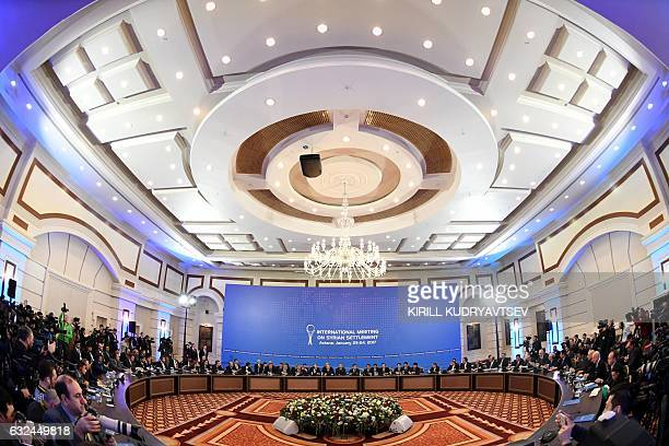 Representatives of the Syria regime and rebel groups along with other attendees take part in the first session of Syria peace talks at Astana's Rixos...