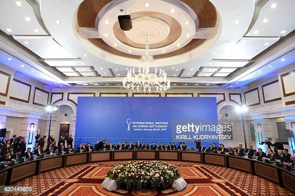 TOPSHOT Representatives of the Syria regime and rebel groups along with other attendees take part in the first session of Syria peace talks at...