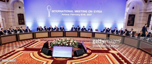 Representatives of the Syria regime and rebel groups along with other attendees take part in the second session of Syria peace talks at the Rixos...