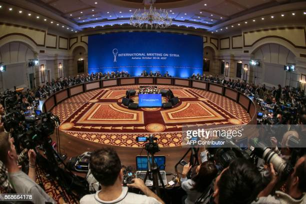Representatives of the Syria regime and rebel groups along with other attendees take part in the session of Syria peace talks in Astana on October 31...