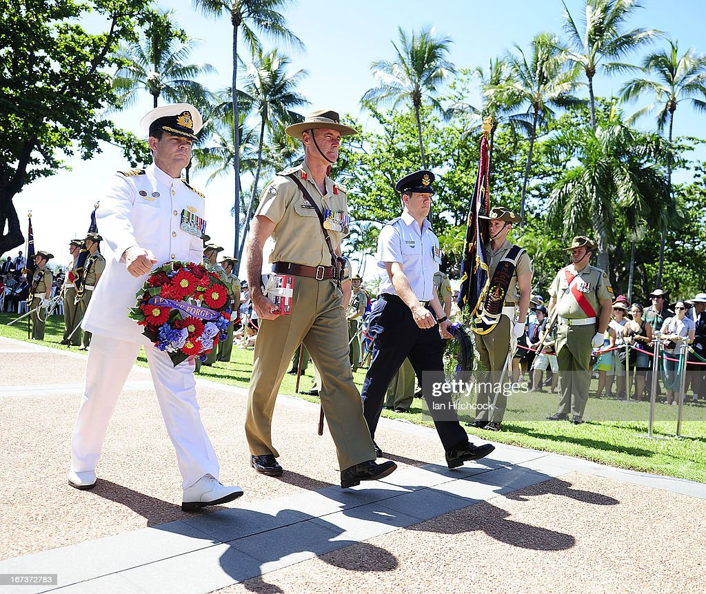 Representatives of the three services of the defence force lay a wreath during a commemorative service on April 25, 2013 in Townsville, Australia. Veterans, dignitaries and members of the public today marked the 98th anniversary of ANZAC (Australia New Zealand Army Corps) Day, April 25, 1915 when allied Australian and New Zealand First World War forces landed on the Gallipoli Peninsula. Commemoration events are held across both countries in remembrance of those who fought and died in all wars.