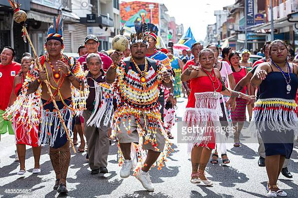 Representatives of various Indigenous Peoples take part in a march in Cayenne the capital of French Guiana on August 9 on the International Day of...