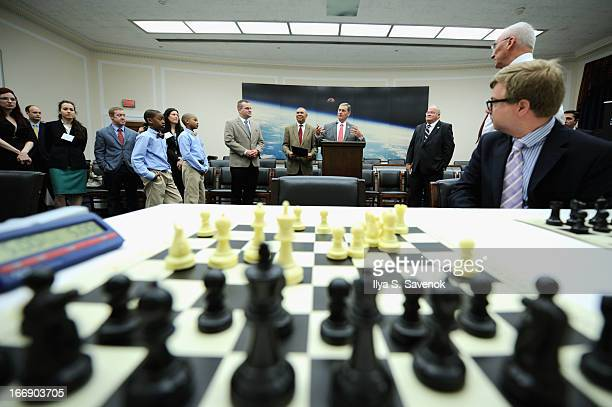 Representatives William 'Lacy' Clay Blaine Leutkemeyer and Billy Long attend a special chess event held at United States Capitol Building on April 18...