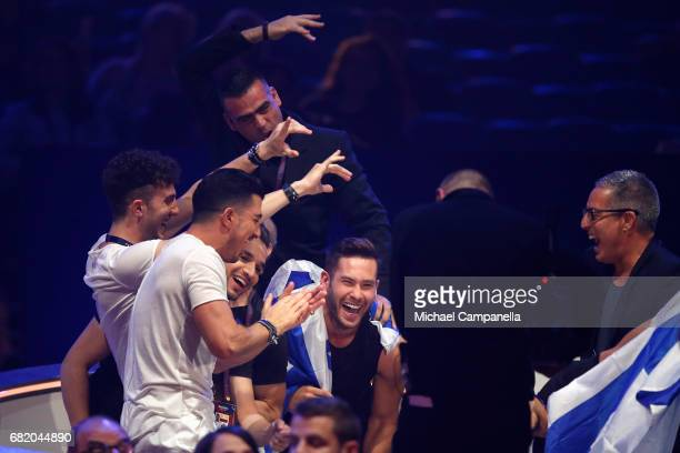 IMRI representing Israel react to making it to the Grand Final during the second semi final of the 62nd Eurovision Song Contest at International...