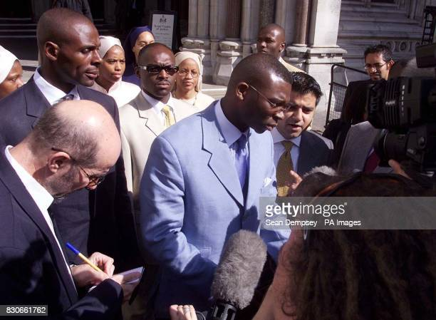 UK Representive of the Nation of Islam Hilary Muhammad with lawyer Sadiq Khan outside the High Court in London following the judgement US black...