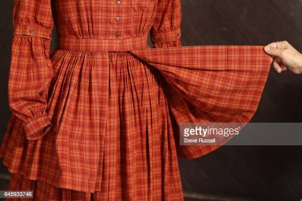 TORONTO ON SEPTEMBER 21 Reproduction of an 1850's work dress worn at Mackenzie House The dress is fashioned after a design titled 'Ladies Working...