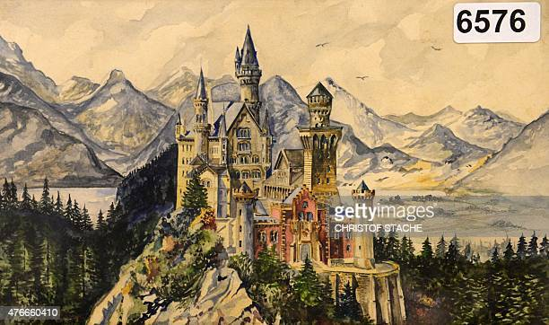 A reproduction shows a painting of Neuschwanstein Castle a watercolor signed A Hitler on June 11 2015 in the Weidler auction house in Nuremberg...