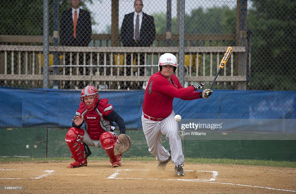 Reps. Austin Scott, R-Ga., right, and Bill Johnson, R-Ohio, participate in republican baseball practice at Simpson Stadium in Alexandria, Va.