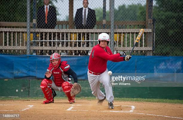 Reps Austin Scott RGa right and Bill Johnson ROhio participate in republican baseball practice at Simpson Stadium in Alexandria Va