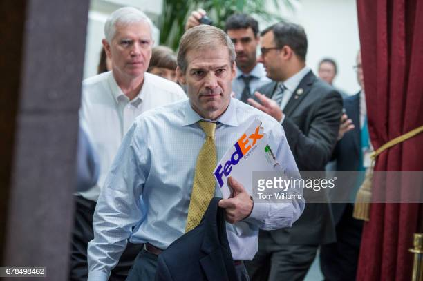 Reps Jim Jordan ROhio center Mo Brooks RAla left and Justin Amash RMich leave a meeting of the House Republican Conference in the Capitol on the day...
