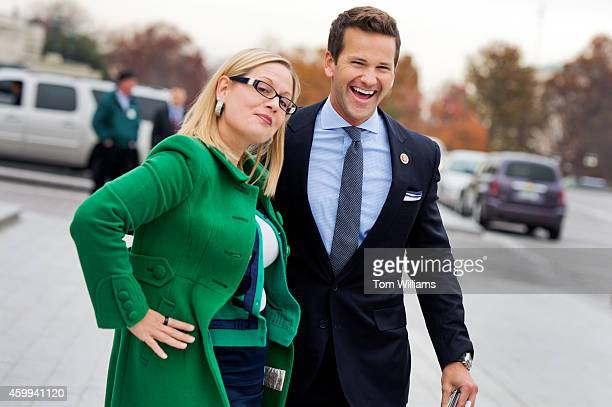 Reps Kyrsten Sinema DAriz and Aaron Schock RIll say goodbye after at the bottom of the House Steps after the last vote of the week in the Capitol...