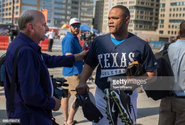 Reps Marc Veasey DTexas right and Louie Gohmert RTexas arrive to play in the 56th Congressional Baseball Game at Nationals Park on June 15 2017