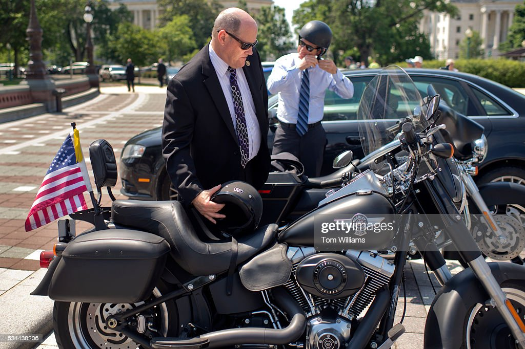 Reps. Reid Ribble, R-Wis., left, and Scott Rigell, R-Va., board their Harley-Davidson motorcycles on the East Front of the Capitol after the last votes in the House which begins the Memorial Day recess, May 26, 2016.