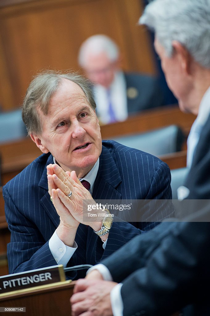 Reps. Robert Pittenger, R-NC., left, and Roger Williams, R-Texas, talk during a House Financial Services committee hearing in Rayburn titled Monetary Policy and the State of the Economy,' featuring testimony by Chair of the Federal Reserve Janet Yellen, February 10, 2016.