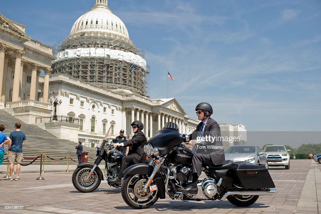 Reps. Scott Rigell, R-Va., right, and Reid Ribble, R-Wis., ride their Harley-Davidson motorcycles on the East Front of the Capitol after the last votes in the House which begins the Memorial Day recess, May 26, 2016.