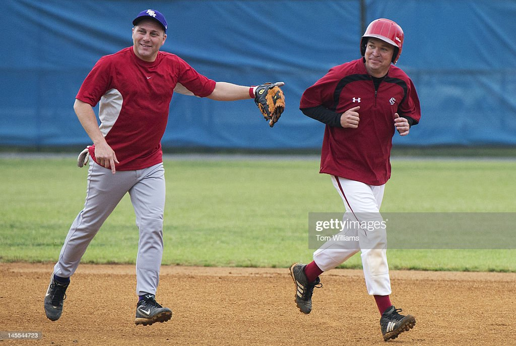 Reps. Steve Scalise, R-La., left, and Mick Mulvaney, R-S.C., participate in republican baseball practice at Simpson Stadium in Alexandria, Va.