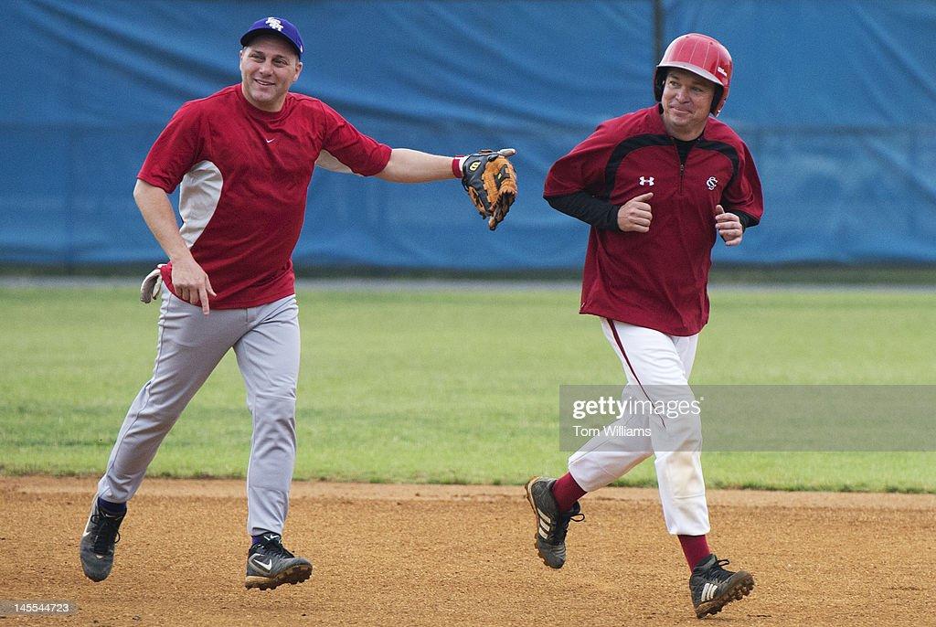 Reps. Steve Scalise, R-La., left, and Mick Mulvaney, R-S.C., participate in republican baseball practice at Simpson Stadium in Alexandria, Va.