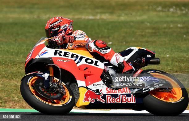 Repsol Honda rider Spanish Marc Marquez competes during the Moto GP free practice session of the Italian Grand Prix at the Mugello track on June 2...