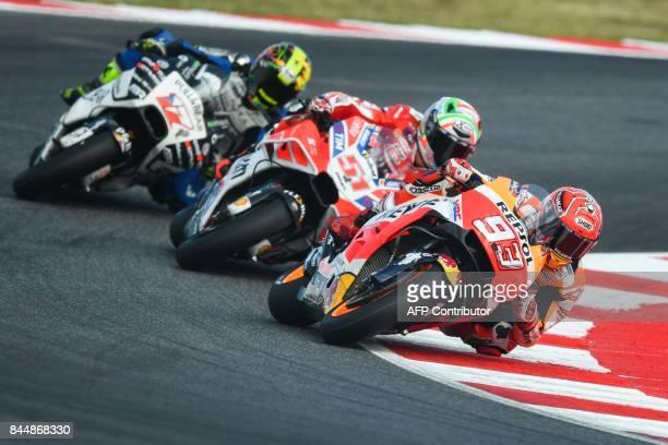 Repsol Honda rider Spanish Marc Marquez Ducati's rider Italian Michele Pirro and Pull Bear Aspar Team's Czech rider Karel Abraham ride their bike...