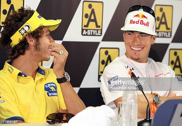 Repsol Honda Team MotoGP rider Nicky Hayden of the US smiles as he chats with Italian Valentino Rossi of Camel Yamaha Team during a press conference...