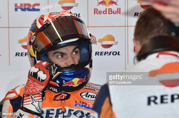 Repsol Honda Team rider Dani Pedrosa of Spain prepares for the second practice session of the Australian MotoGP Grand Prix at Phillip Island on...