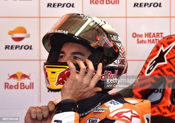 Repsol Honda Team rider Marc Marquez of Spain gets ready for the first practice session of the Australian MotoGP Grand Prix at Phillip Island on...