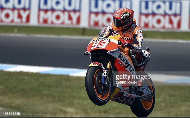 Repsol Honda Team rider Marc Marquez of Spain lifts the front wheel at the end of a warm up session ahead of the MotoGP Australian Grand Prix at...