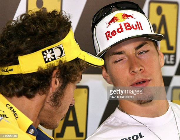 Repsol Honda Team's MotoGP rider Nicky Hayden of the US chats with Italian Valentino Rossi of Camel Yamaha Team during a press conference for the...