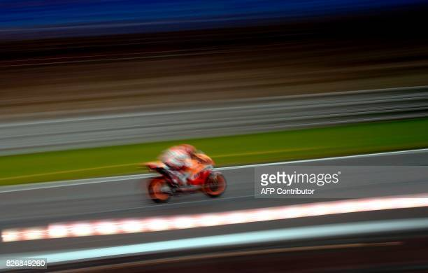 Repsol Honda team's Spanish driver Marc Marquez rides his Honda during the warmup of the Moto GP Grand Prix of the Czech Republic in Brno on August 6...
