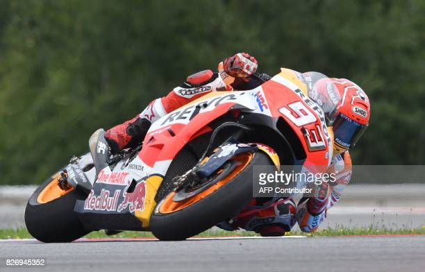 Repsol Honda Team's Spanish driver Marc Marquez rides his Honda to win the MotoGP event of the Grand Prix of the Czech Republic in Brno on August 6...