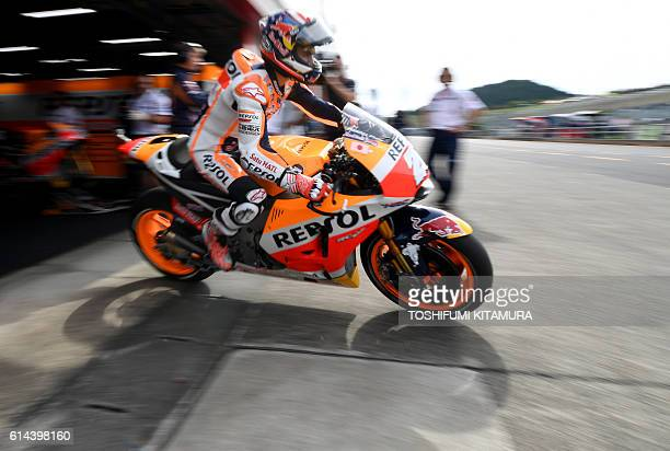 TOPSHOT Repsol Honda Team's Spanish rider Dani Pedrosa leaves his pit during the first MotoGPclass free practice at the Japanese Grand Prix at the...