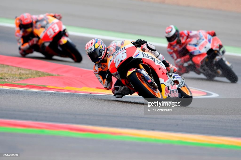 Repsol Honda Team's Spanish rider Dani Pedrosa rides ahead of Ducati Team's Spanish rider Jorge Lorenzo (R) and Repsol Honda Team's Spanish rider Marc Marquez during the Moto GP second free pratice of the Moto Grand Prix of Aragon at the Motorland circuit in Alcaniz on September 22, 2017. /
