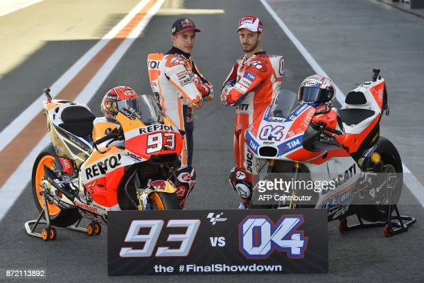 TOPSHOT Repsol Honda Team's Spanish rider Marc Marquez and Ducati Team's Italian rider Andrea Dovizioso pose during a photocall in Valencia on...
